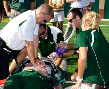 Unconscious Athlete Getting CPR by his Coach